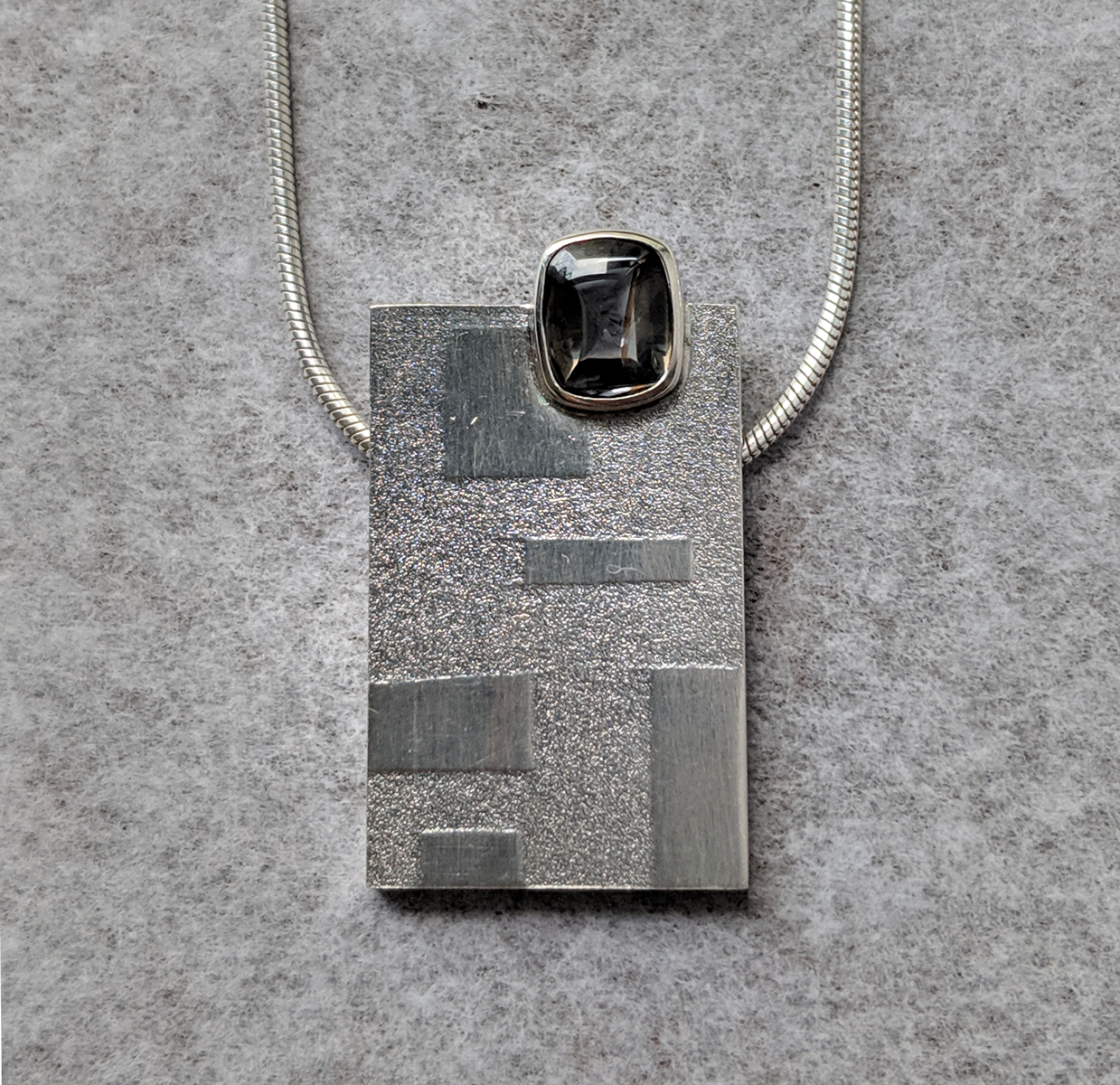 Grey Spinel and Silver Imprinted Squares Pendant