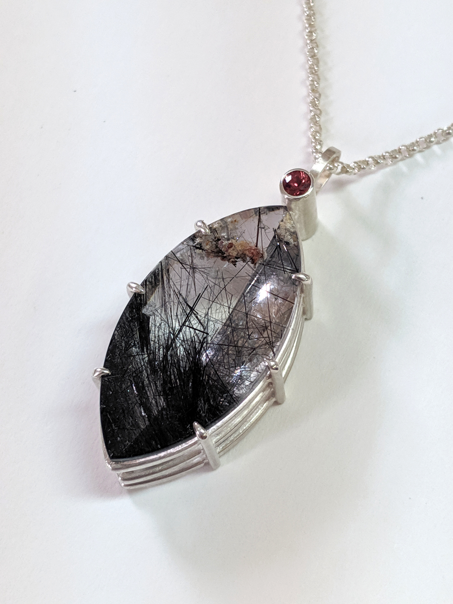 Tourmalinated Quartz and Red Sapphire in Silver Basket Setting