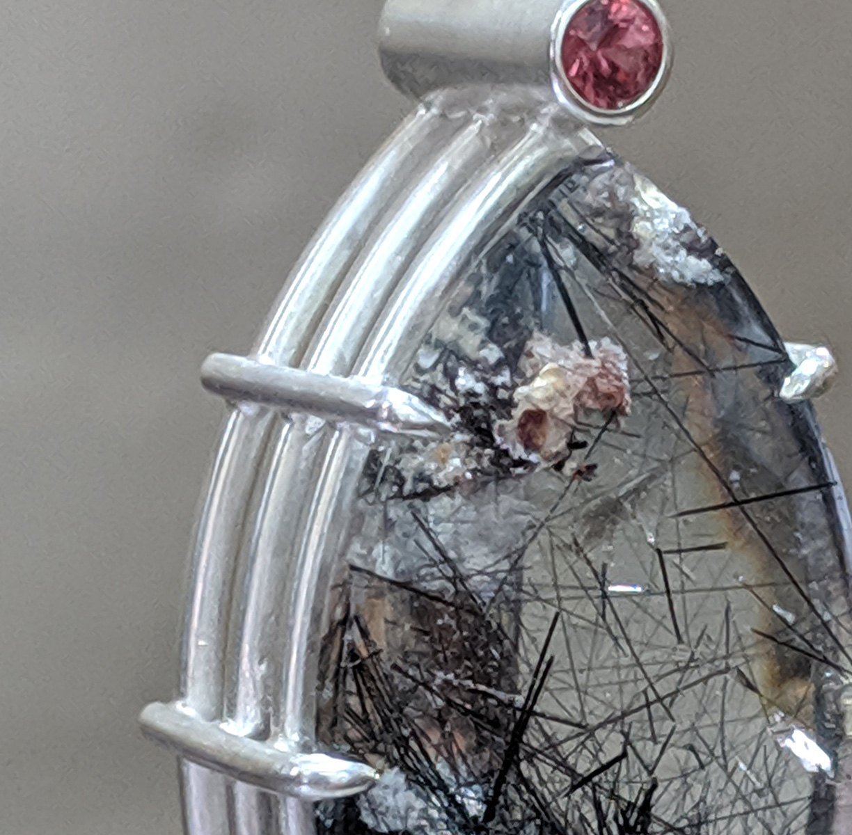 Tourmalinated Quartz with Inclusions and Red Sapphire Pendant Detail