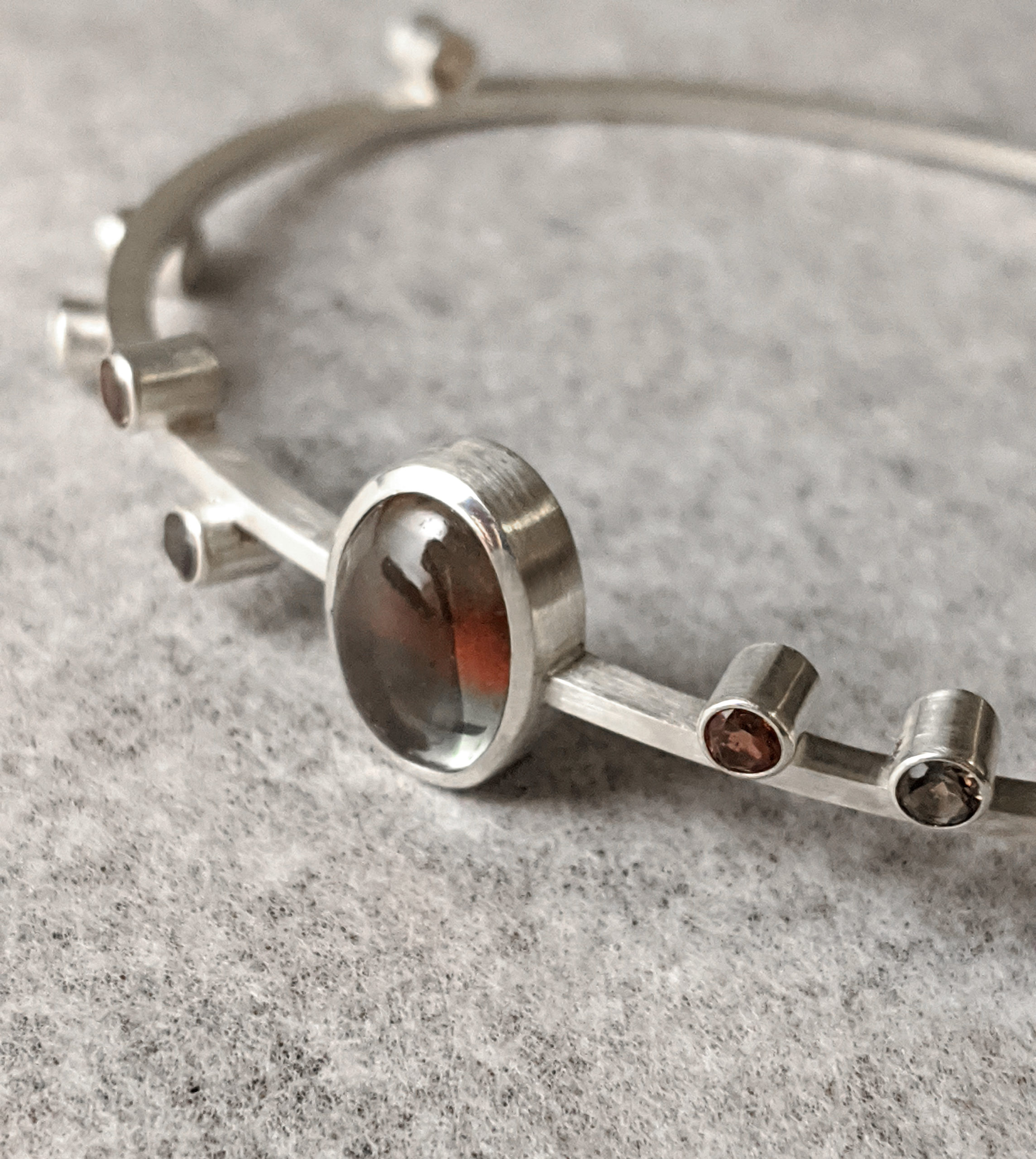 Oval Bangle Bracelet in Silver with Red and Green Oregon Sunstone Cabochon and Multi-colored Sunstones
